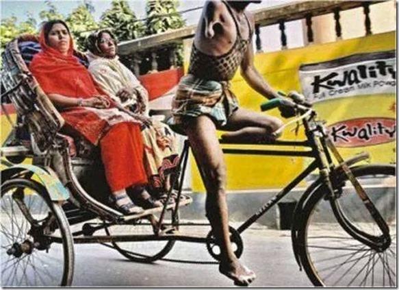 man one hand one leg rickshaw puller