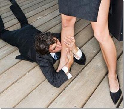 man on ground kissing woman's leg